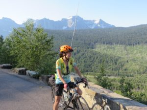 Julie Kumble admires a mountainous view during a cross-country bike trip.
